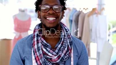 Fashion designer hanging a measuring tape around his neck
