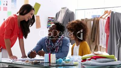 Fashion designers working together in their studio