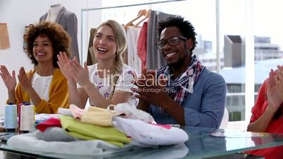 Fashion designers applauding together