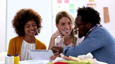 Fashion designers working with a tablet pc