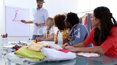 Fashion designer presenting a sketch of a dress