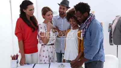 Fashion designer presenting her sketch of a dress