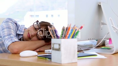 Pretty designer napping on her desk