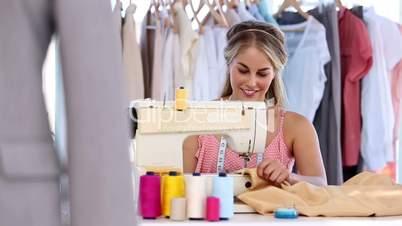 Creative fashion desginer using a sewing machine