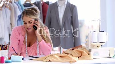 Fashion designer on the phone