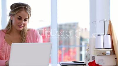 Fashion designer working on her laptop