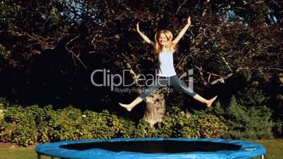 Little girl having fun on a trampoline