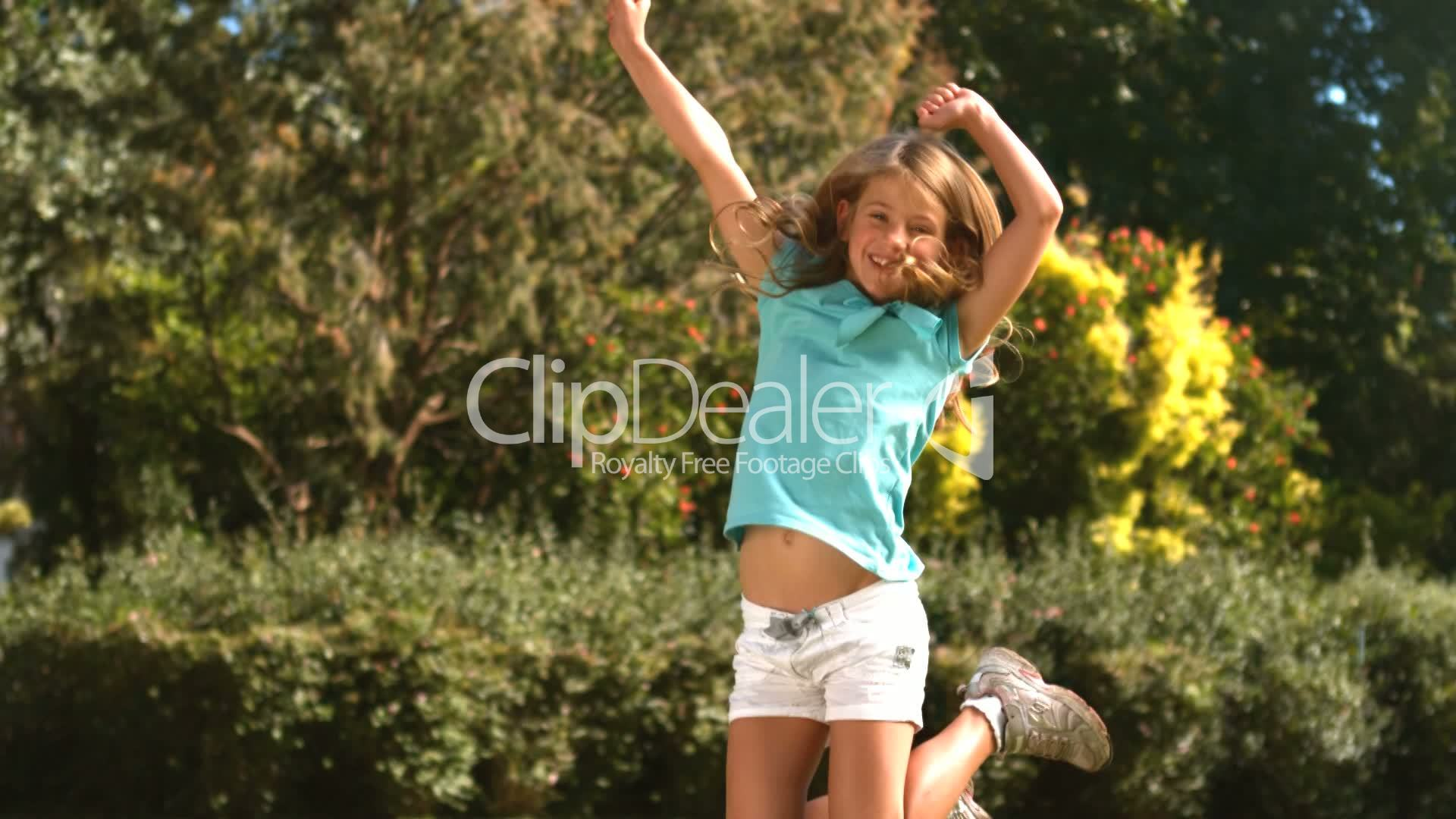Cute little girl jumping in her garden: Royalty-free video and stock ...
