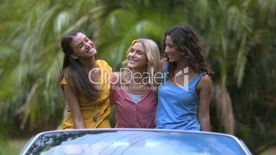 Friends smiling and shaking their hair