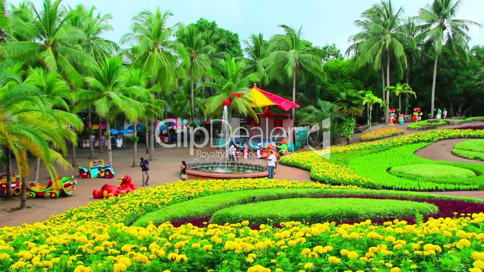 peoples walks in nong nooch tropical garden in thailand royalty