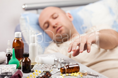 Unwell man patient lying down bed