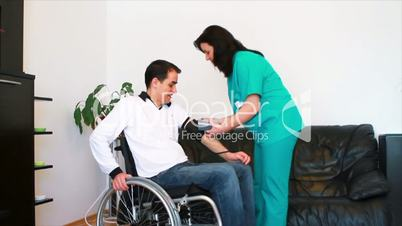 Blood pressure check for young adult in wheelchair