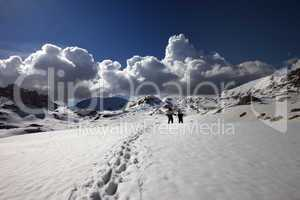 hikers on snow plateau