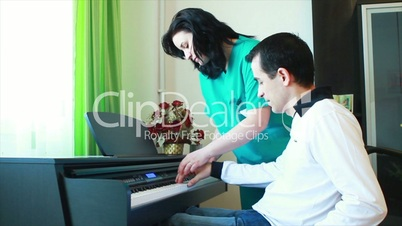 Physical Therapy for young man in wheelchair using piano.