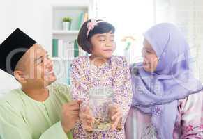 Southeast Asian Malay family saving money