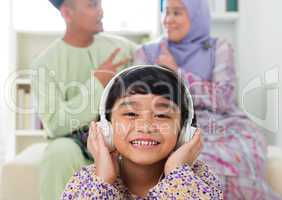 Muslim girl listening to song