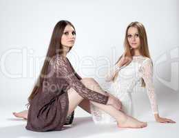 Charming models with long hair posing in dresses