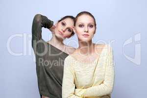 Image of young fashionable models posing in studio