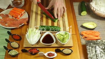 Chopping cucumber for Sushi roll