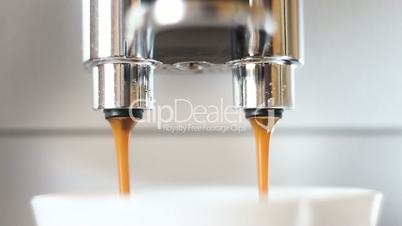 machine pouring coffee extremely close-up