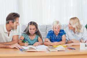 Parents helping their children doing their homework