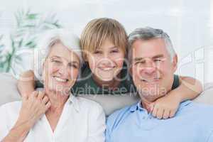 Grandson embracing his grandparents