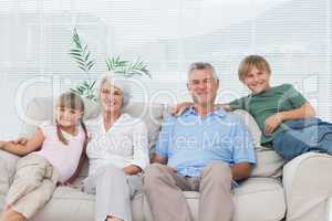 Grandparents and grandchildren sitting on couch