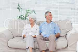 Elderly couple sitting on sofa