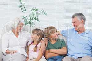 Grandparents speaking with their grandchildren