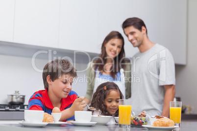 Children having breakfast in kitchen
