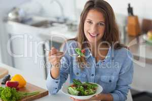 Pretty woman eating a salad
