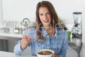 Attractive woman eating cereal