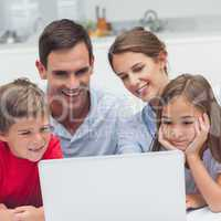Parents and children using a laptop