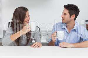 Couple drinking cups of coffee