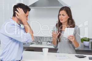 Angry couple doing their accounts