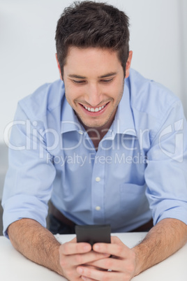 Man text messaging with his smartphone