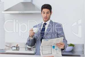 Businessman being astonished when reading the news