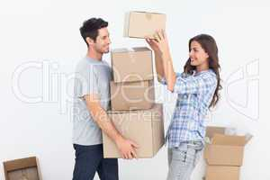 Woman giving boxes to her husband while they are moving