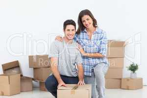 Portrait of a woman and her husband wrapping a box