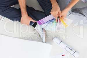Couple looking at color charts