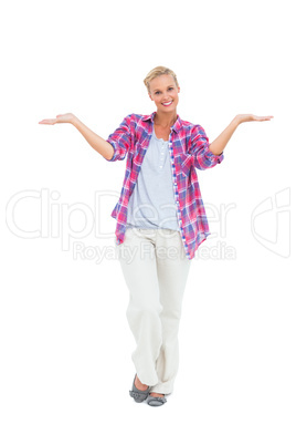 Blonde woman standing with arms open