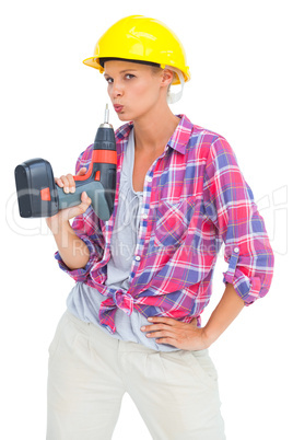 Serious handy woman with a power drill