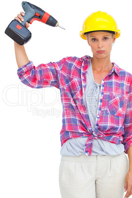Blonde handy woman holding a power drill