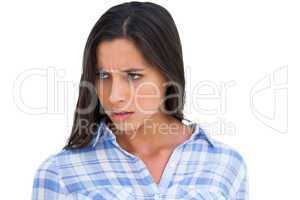 Angry brunette looking at camera