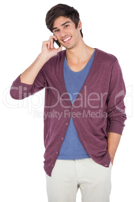 Smiling man speaking on the phone