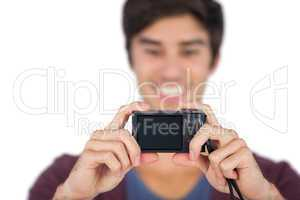 Young man taking picture of himself