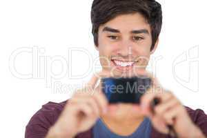 Young man using digital camera
