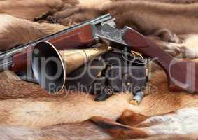 Closeup of hunter gun on fur background