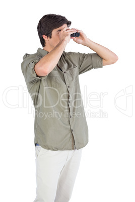 Man looking for something with binoculars