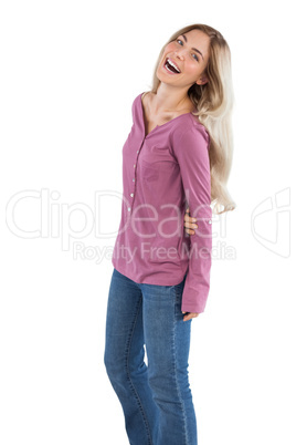 Cheerful woman with arms behind her back